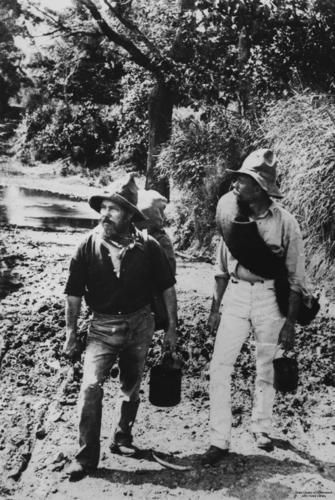 Two swagmen dressed in typical Queensland male fashion